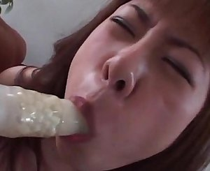 Boob teased Japanese nympho simulating BJ with thick dildo